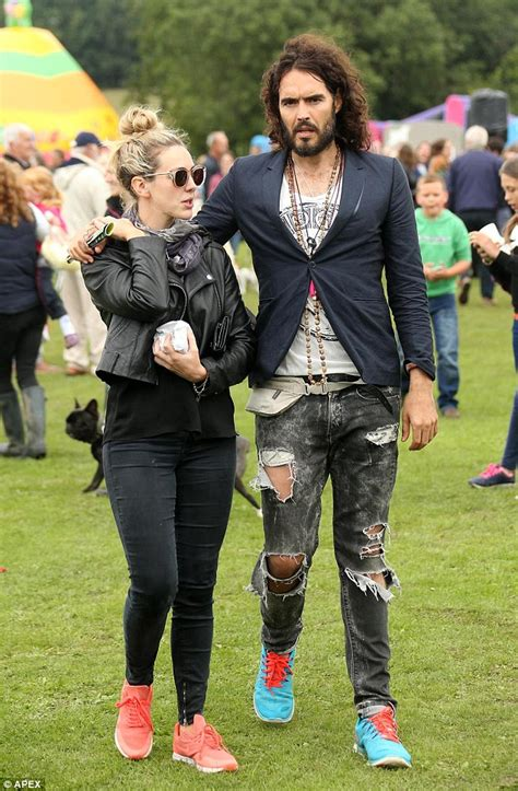 Russell Brand wraps his arm around Kirsty Gallacher's